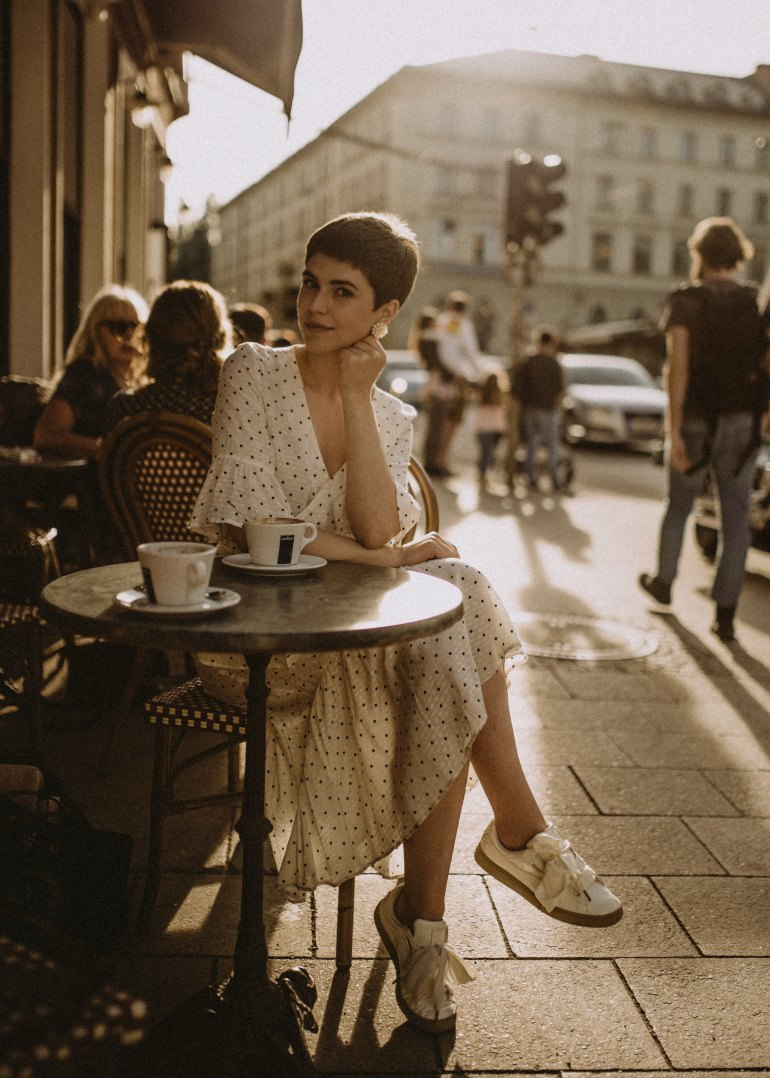 Girl drinking coffee al fresco European city