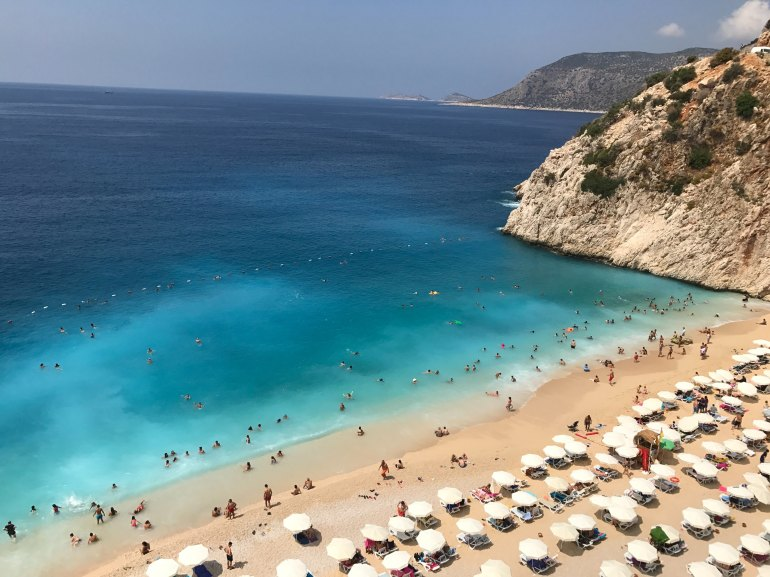 beach full of holidaymakers in Turkish Riviera