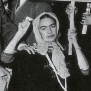 Frida Kahlo at Communist protest with fist raised