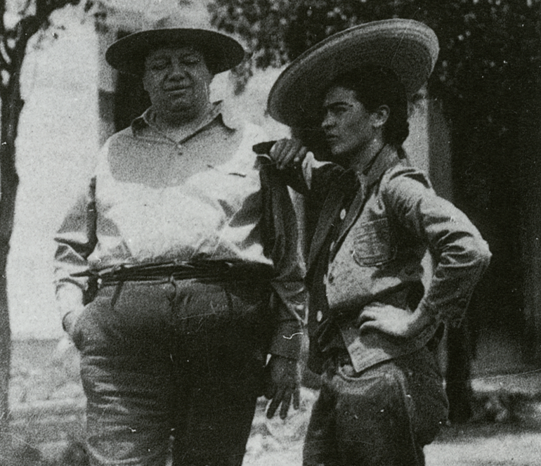 black and white photograph of Frida Kahlo wearing a sombrero with Diego Rivera