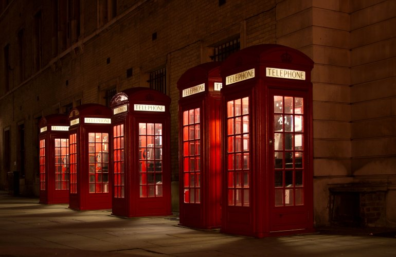 red telephone boxes in London at night