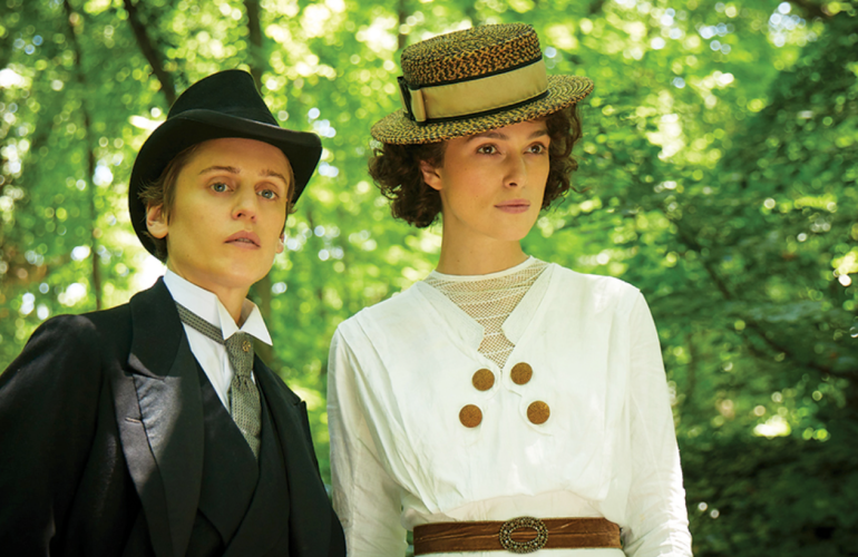Keira Knightley as Colette and Denise Gough as Missy standing together in Colette (2018)
