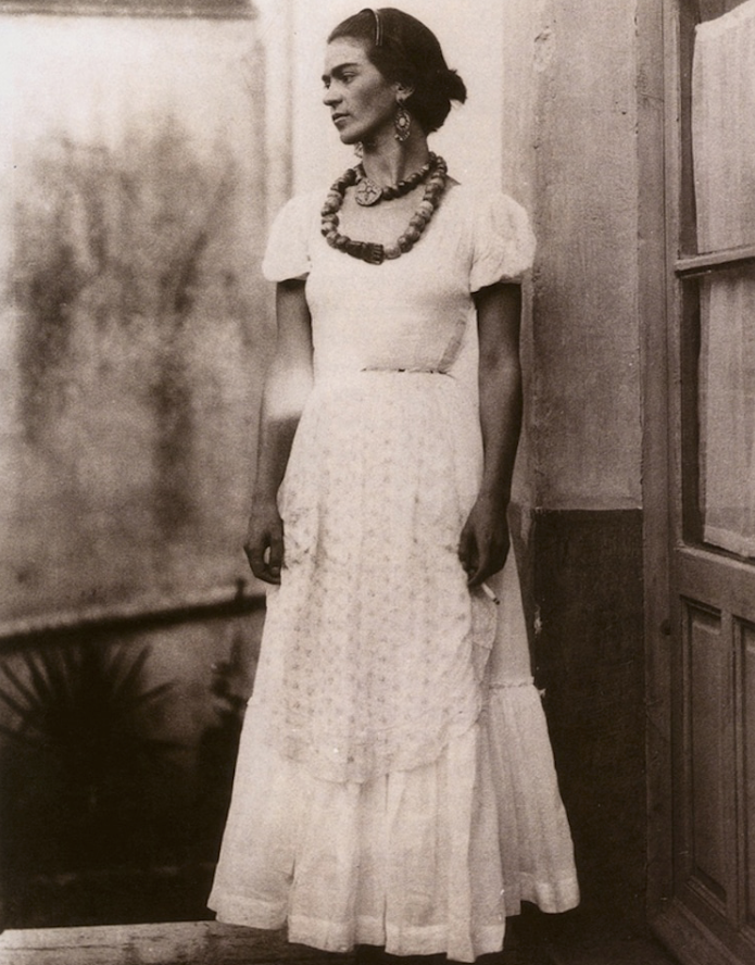 Frida Kahlo with cigarette and white dress 1929, Photographed by Guillermo Davila